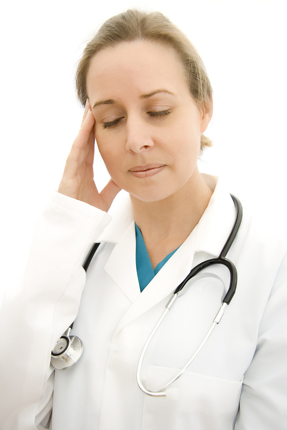 Doctor experiencing tension headache